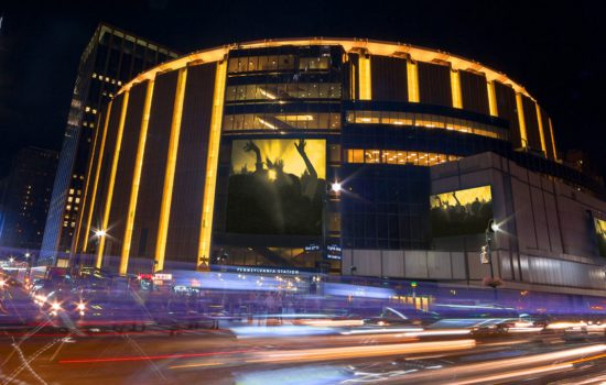 The Madison Square Garden shines at night.